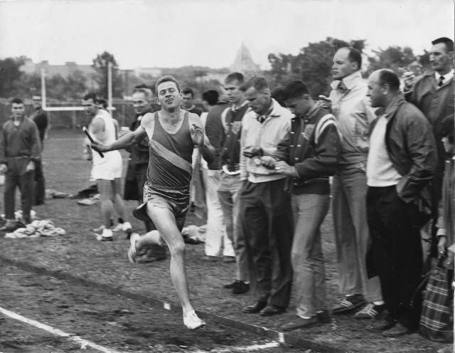 George Gluppe winning a relay race