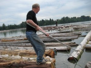 Norbert Kaysser working with logs on the river
