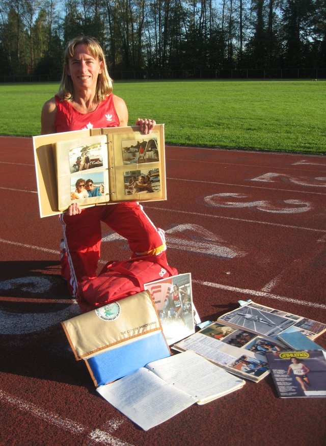 Sitting on a track surrounded by running photos and scrapbooks