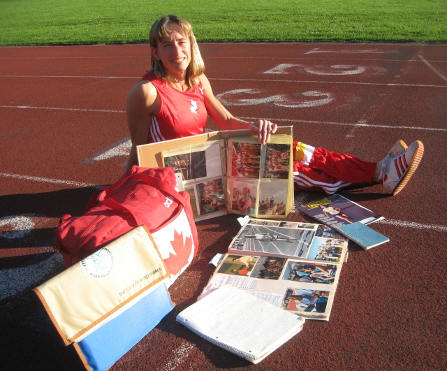 Sitting on a track surrounded by scrapbook, photo book and journals