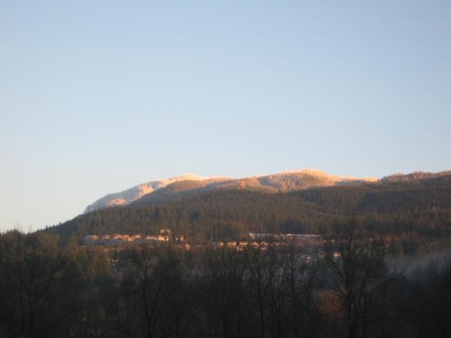Sun on mountain peaks.