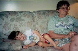 Grandmother with sleeping toddler.