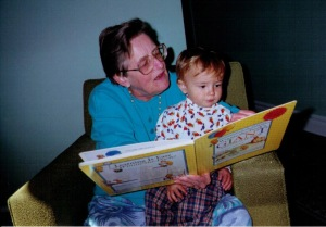 Grandmother reading to grandson.