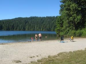 family playing at Sasamat Lake