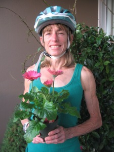 Nancy with bicycle helmet and flowers