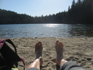 bare feet on the beach at Sasamat Lake