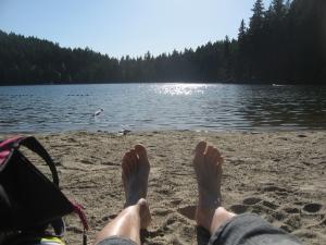 bare feet on the beach at Sasamat Lake