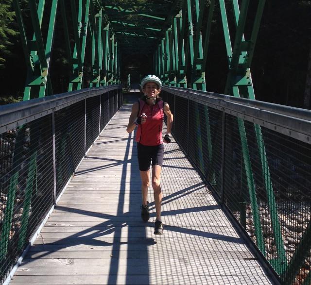 Nancy running on bridge near fish hatchery