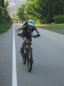 Nancy riding uphill from Ioco