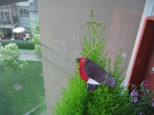 bird ornament in miniature tree